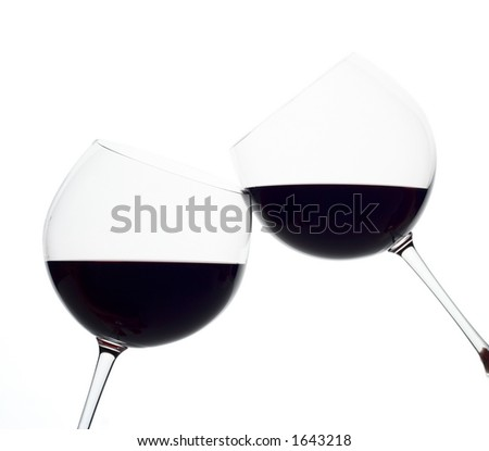 Two wine glasses touching each other (clipping path included)