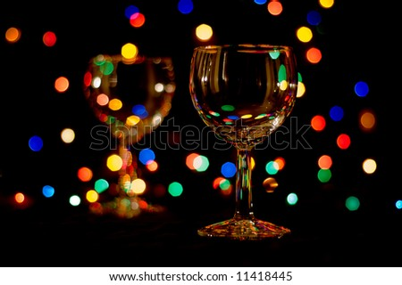 two wine glasses with colored flares
