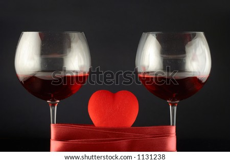 Two wine glasses wrapped with tape and heart