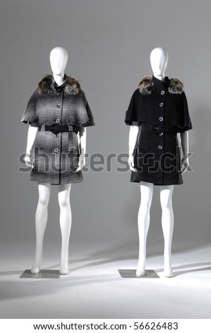 Two Winter coat dress on mannequin
