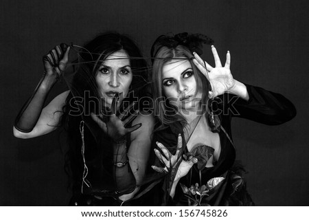 two witches on a black background #156745826