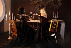 Two witches perform a magic ritual love spell. Magic. fantasy beautiful girls in the image of a witch in a dark gothic room. Concept magic, fantasy, Halloween