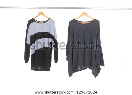 Two woman clothes on a hanger studio isolated