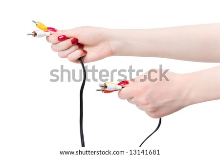 Two woman hands holding tv cable pins. Isolated on white.