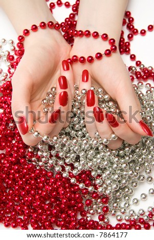 Two woman hands with glassbeads. On white background.