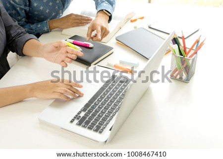 Two woman learn and teach tutor out of the class room concept education and also use computer and tablet to help teaching