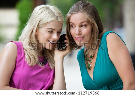 Two Woman Talking on Mobile Phone