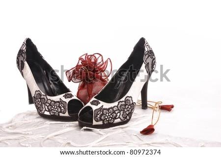 Two women black shoes composition