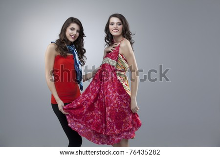 two women choosing flowers red dress