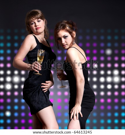 two women dancing on the disco party - stock photo