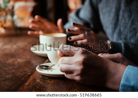 Two women discussing business projects in a cafe while having coffee #519638665