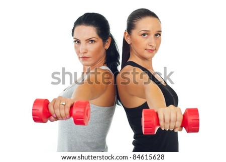 Two women doing exercises with barbell isolated on white background