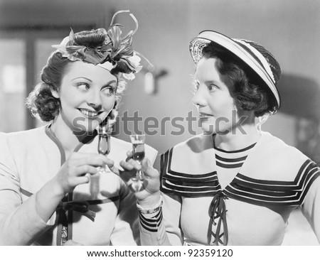 Two women drinking a schnapps Zdjęcia stock ©