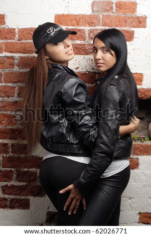 women embrace red bricks wall background. More images of this models ...