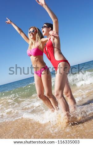 Two Women Enjoying Beach Holiday