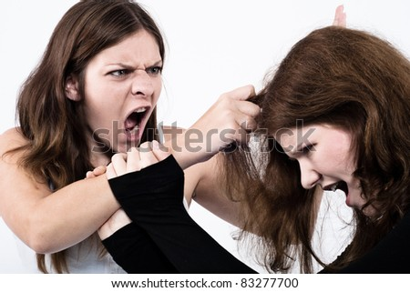 Two women fighting and screaming
