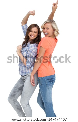 Two women having fun on white background
