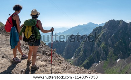 two women hikers on the trail of the Pic du Midi de Bigorre in the Pyrenees