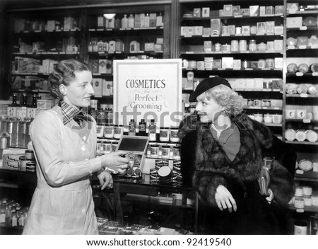 two women in a drug store...
