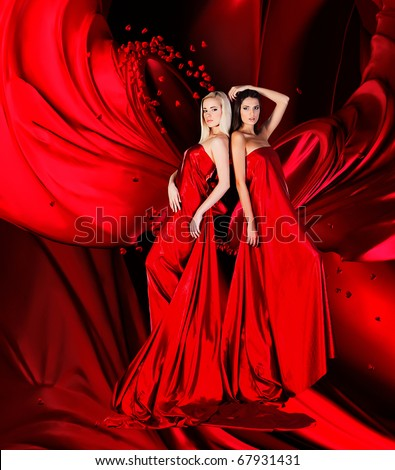 Long Dress on Two Women In Red Dress With Long Hair And Hearts On Red Drapery Stock