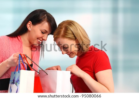 Two women looking in their shopping bags