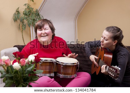 Two women make a music therapy and having fun