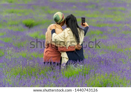 Two women making selfie picture on the lavender field