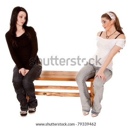 Two women not wanting to sit next to each other with expressions on their faces.