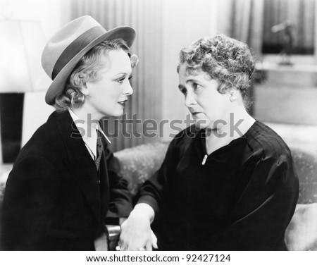 two women  one older  talking...