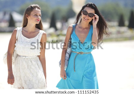 Two women over street background