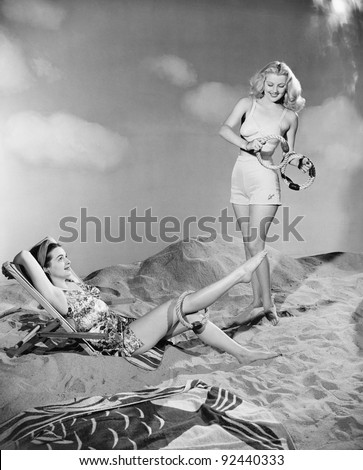 Two women relax at the beach