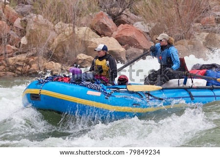 Two Women Rowing a Rapid - Grand Canyon National Park - stock photo