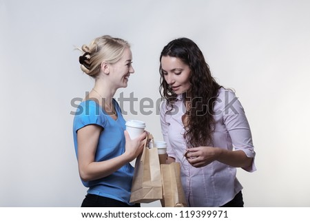two women sharing food and having fun during their lunch break