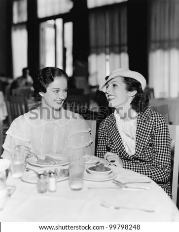 Two women sitting together in a restaurant Zdjęcia stock ©