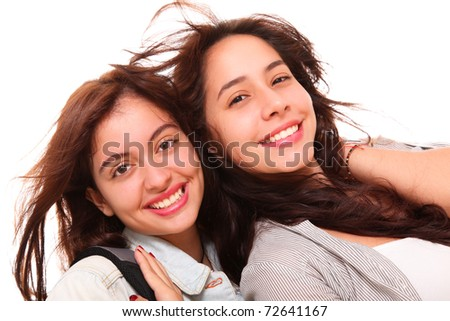 Two women smiling at the camera over white background