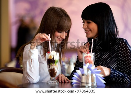 two  women speaking in caffee