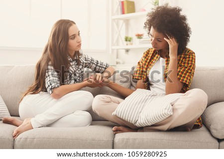Two women talking about problems at home. Friendship consoling and care, unhappy girl support her girlfriend, copy space
