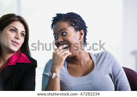 Two women talking and laughing