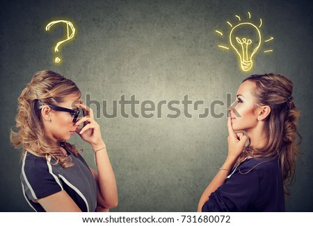 Two women thinking one has a question another solution with light bulb above head isolated on gray background. #731680072
