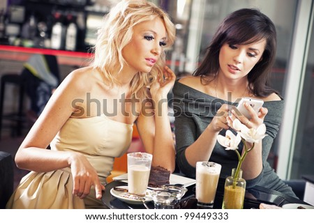 Two women using a smart phone