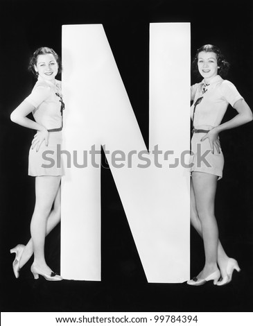 Two women with huge letter N