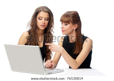 Two women working on a laptop computer. Isolated background