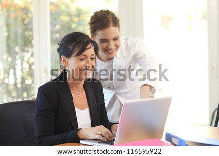 Two women working together in the office
