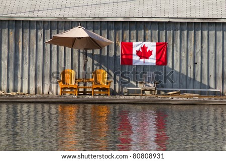 Two wooden chairs and Canadian Flag