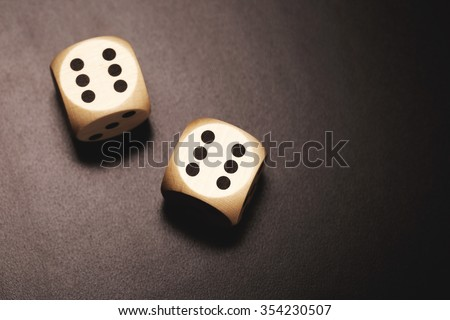 Two wooden dices on a black background. Happy combination of two sixes #354230507