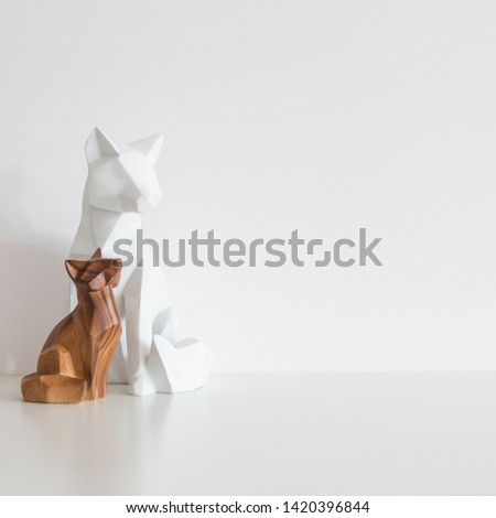 Two wooden foxes. Modern home decor.