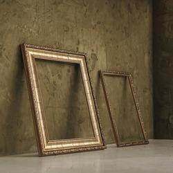 Two wooden golden empty frames on the floor