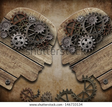 two wooden heads with gears...