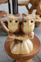two wooden owl carved out of wood.