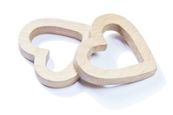 two wooden symbol toys hearts isolated on white